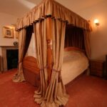 Handmade curtains, bedding, vallance and upholstered tented ceiling
